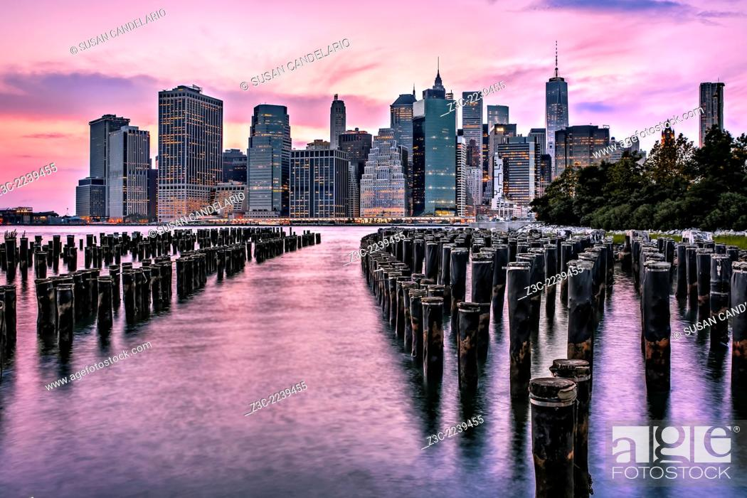 Stock Photo: Great view of the New York City lower Manhattan Skyline during a dramatic sunset. One World Trade Center (WTC) commonly referred to as the Freedom Tower along.