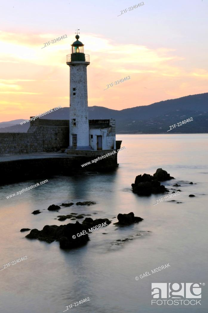 Stock Photo: Propriano's lighthouse at sunset, Corsica, France.