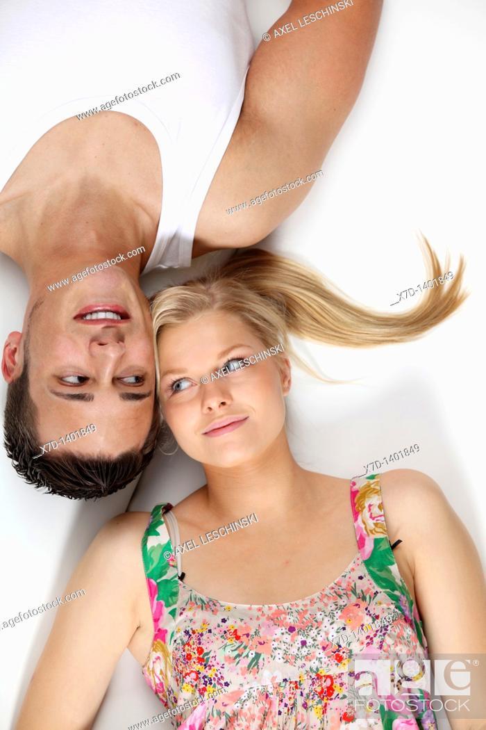Stock Photo: couple lying on sofa.