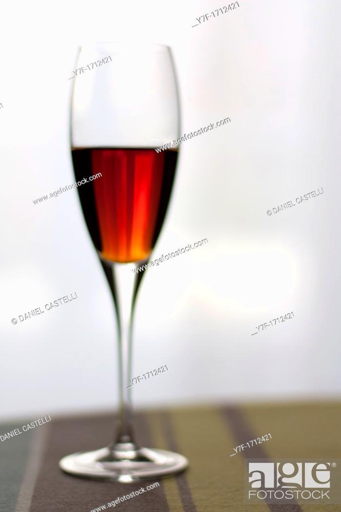 Stock Photo: Liquor crystal glass on table.