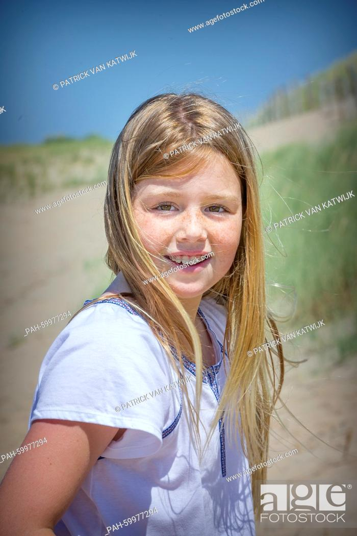Stock Photo: Princess Alexia of The Netherlands pose for the media at the start of their summer holidays at the beach of Wassenaar, The Netherlands, 10 July 2015.