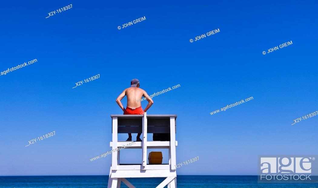 Stock Photo: Lifeguard watches over ocean waters, Cape Cod National Seashore, Cape Cod, MA, Massachusetts, USA.