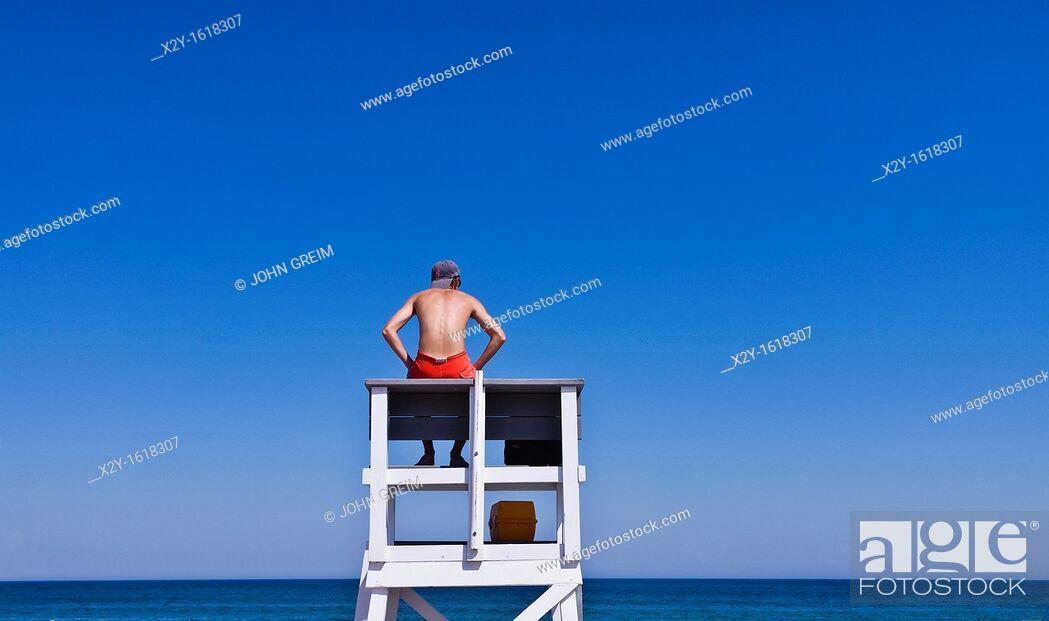 Stock Photo: Lifeguard watches over ocean waters, Cape Cod National Seashore, Cape Cod, MA, Massachusetts, USA.
