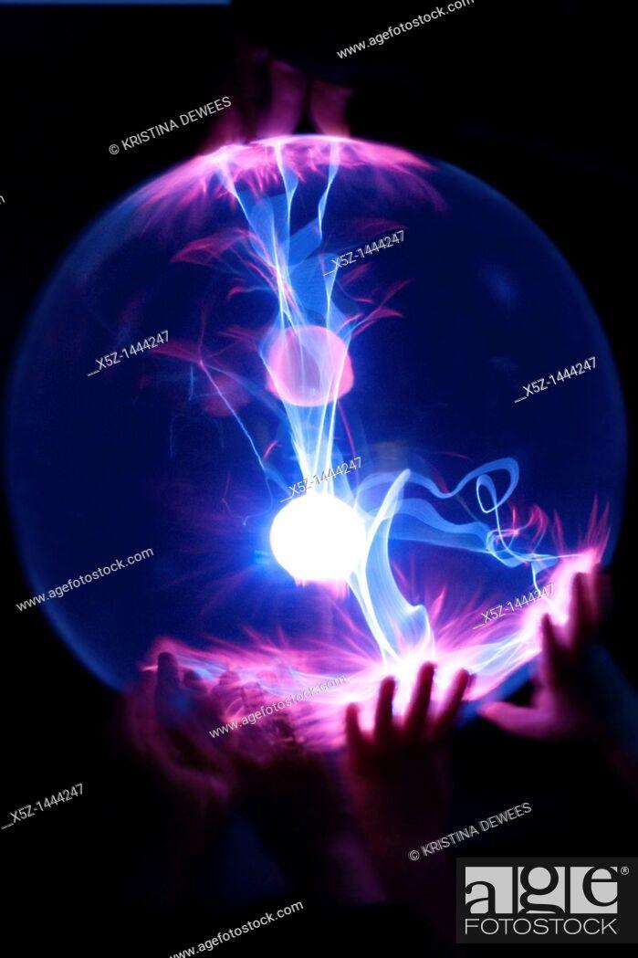 Stock Photo: Children's hands on a Plasma Globe.