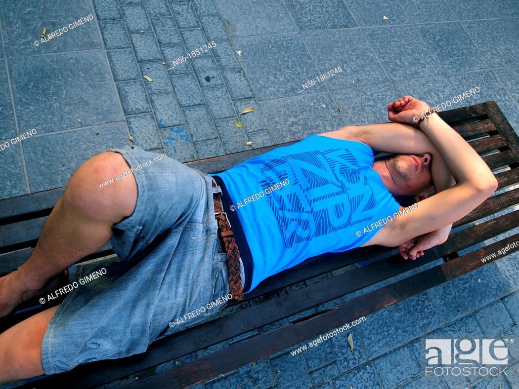 Stock Photo: Man awakening on a bench.