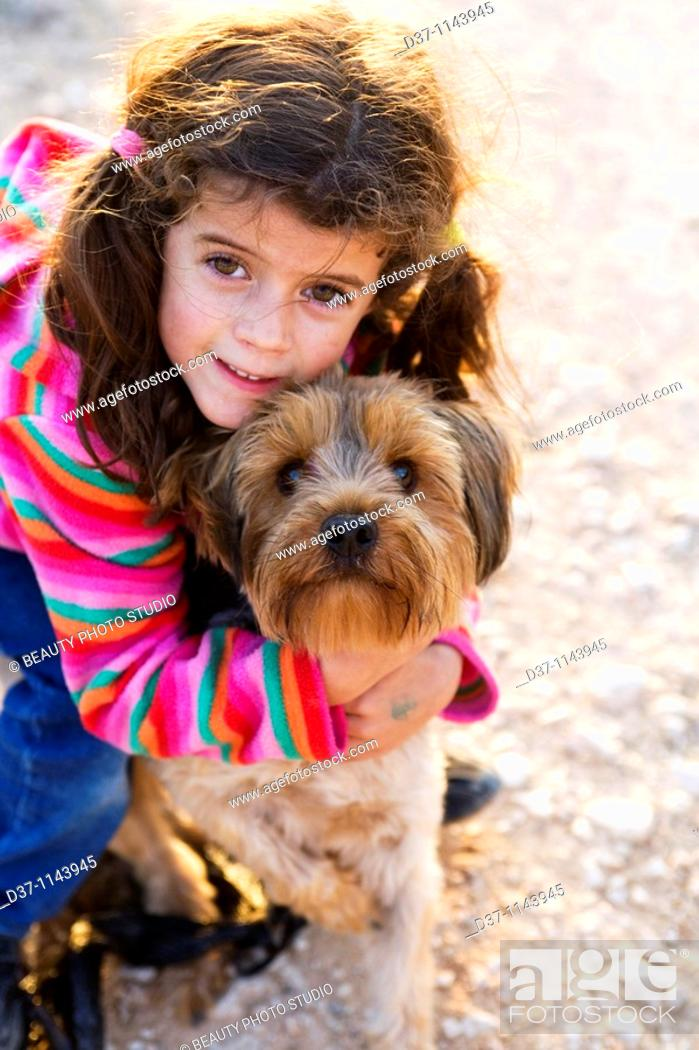 Stock Photo: Little girl with a Yorkshire Terrier dog.