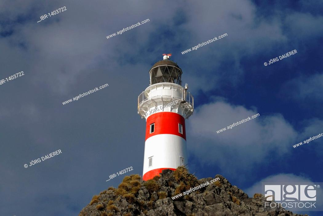 Stock Photo: Clouds above Cape Palliser Lighthouse at the Cook Strait at the southern tip of the North Island, New Zealand.