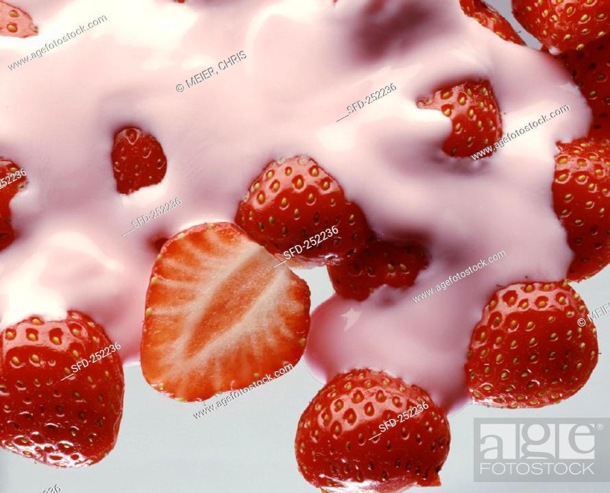 Stock Photo: Strawberry yoghurt with fresh strawberries.