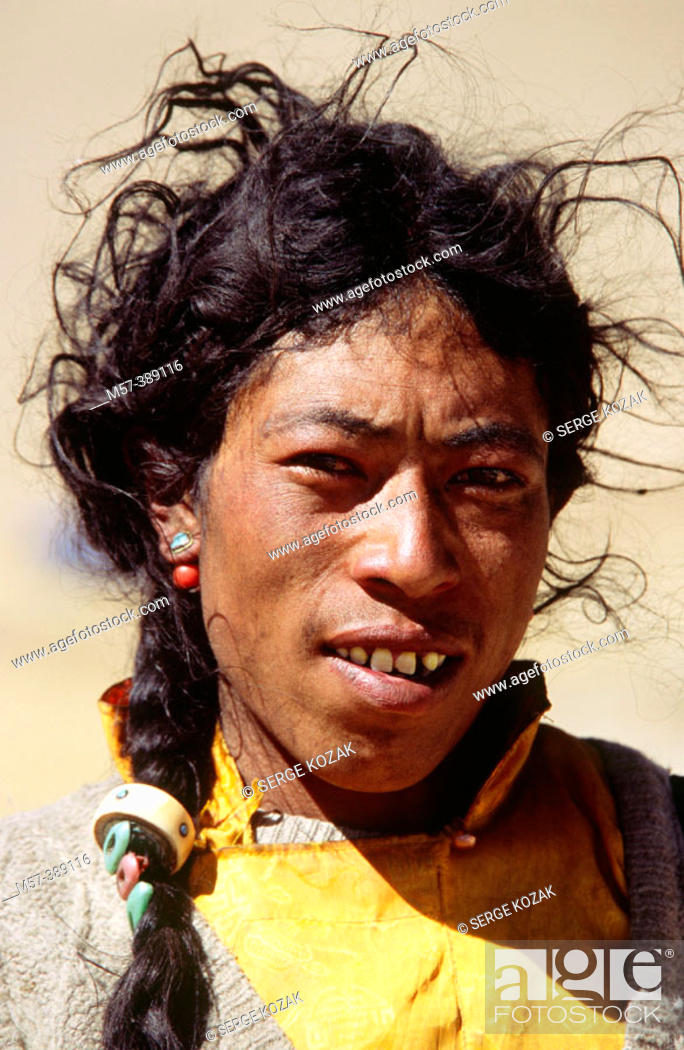 Stock Photo - Portrait of one young to middle-aged Himalayan herder with  black oily messy hair, Tibet, China.