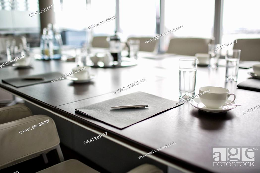 Stock Photo: Table set for meeting in office.