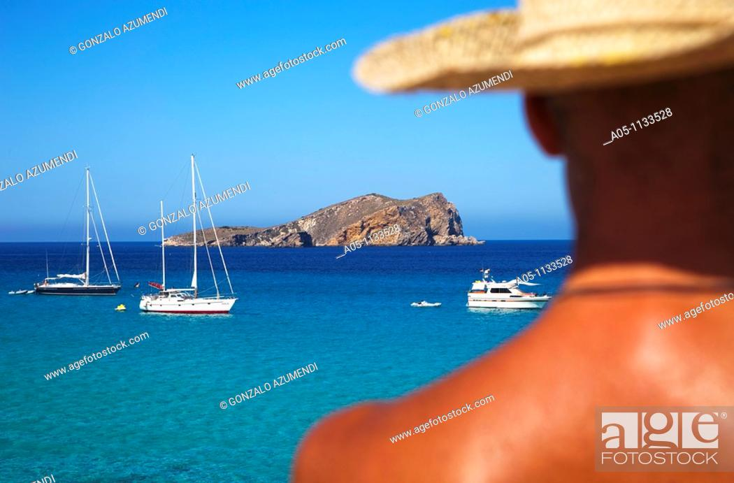 Stock Photo: Man with straw hat. Comte Beach. Ibiza. Balearic Islands.Spain.