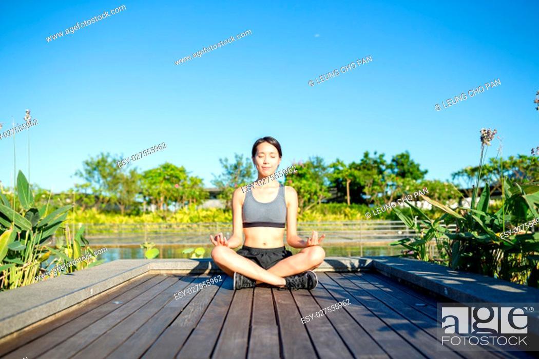 Stock Photo: Woman sitting in yoga pose.
