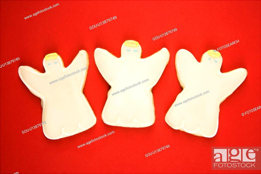 Stock Photo: Three angel sugar cookies with decorative icing.