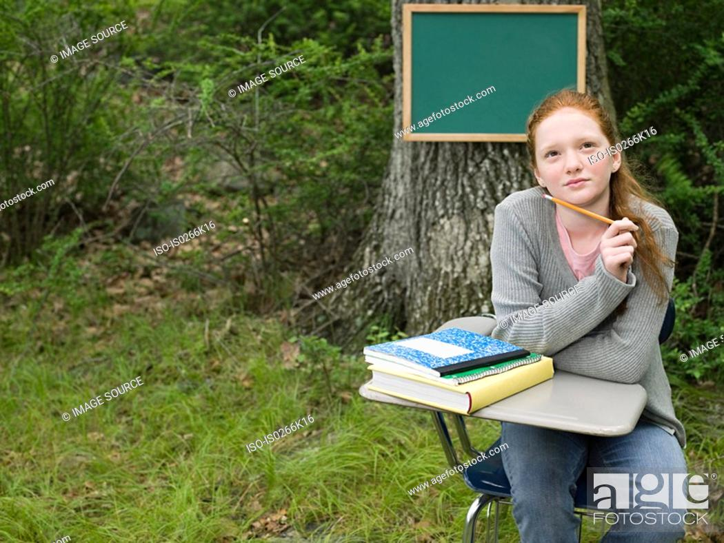 Stock Photo: A girl thinking.