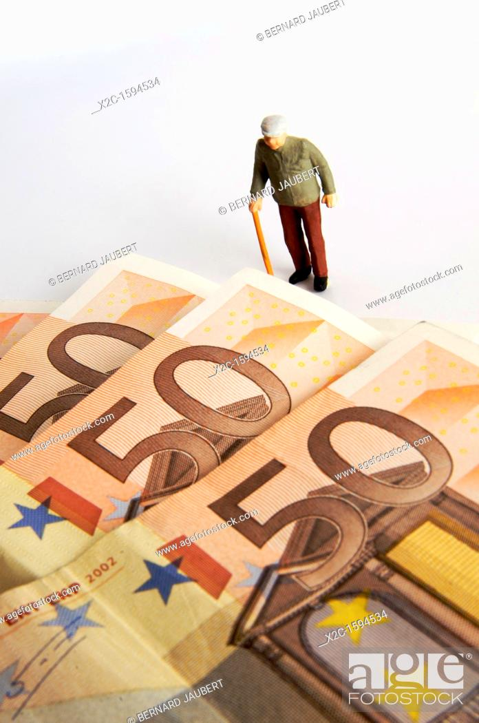 Stock Photo: Elderly man, figurine, and euro notes.