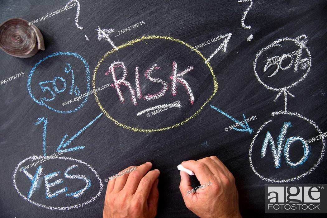 Stock Photo: Written with chalk on graphic representation of the word risk whiteboard.