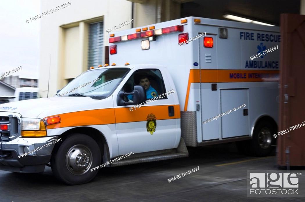 Stock Photo: Asian male paramedic driving ambulance.
