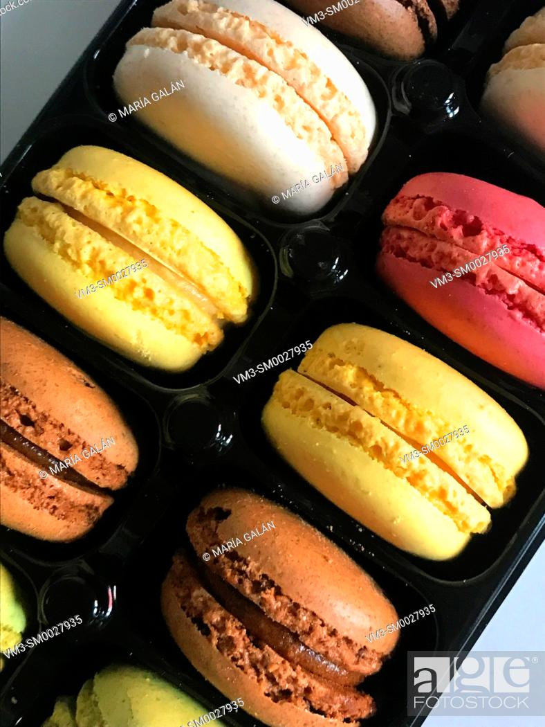 Stock Photo: Assorted macarons in a container.