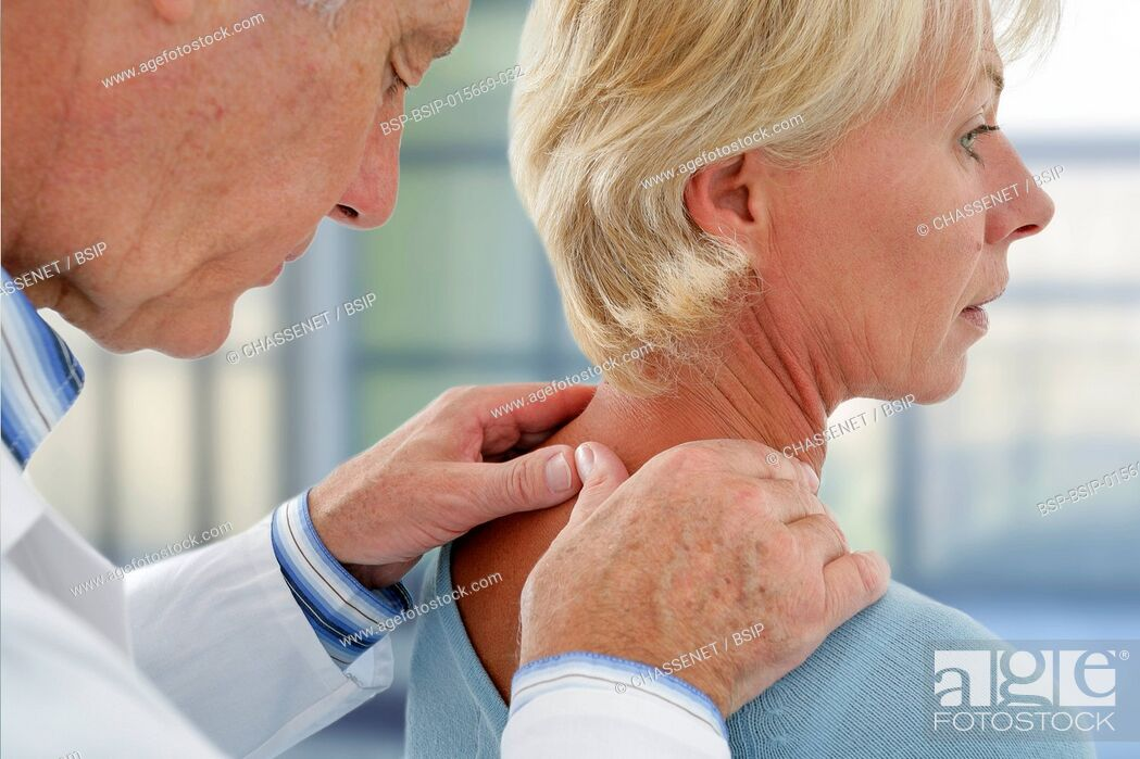 Stock Photo: Doctor examining the neck of a patient.