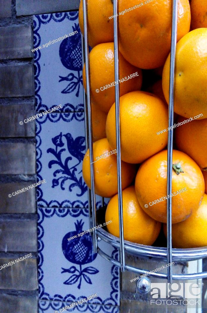 Stock Photo: basket of oranges and squeeze machine.
