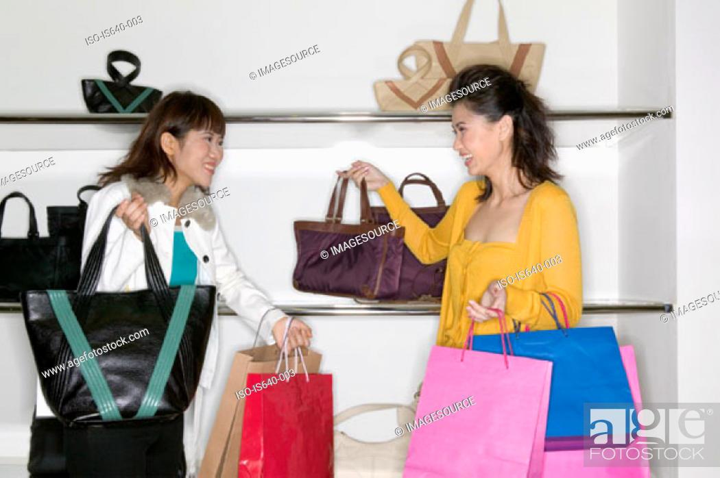 Stock Photo: Women shopping for handbags.