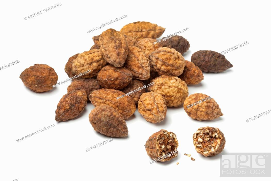 Photo de stock: Heap of dried caperberries on white background.