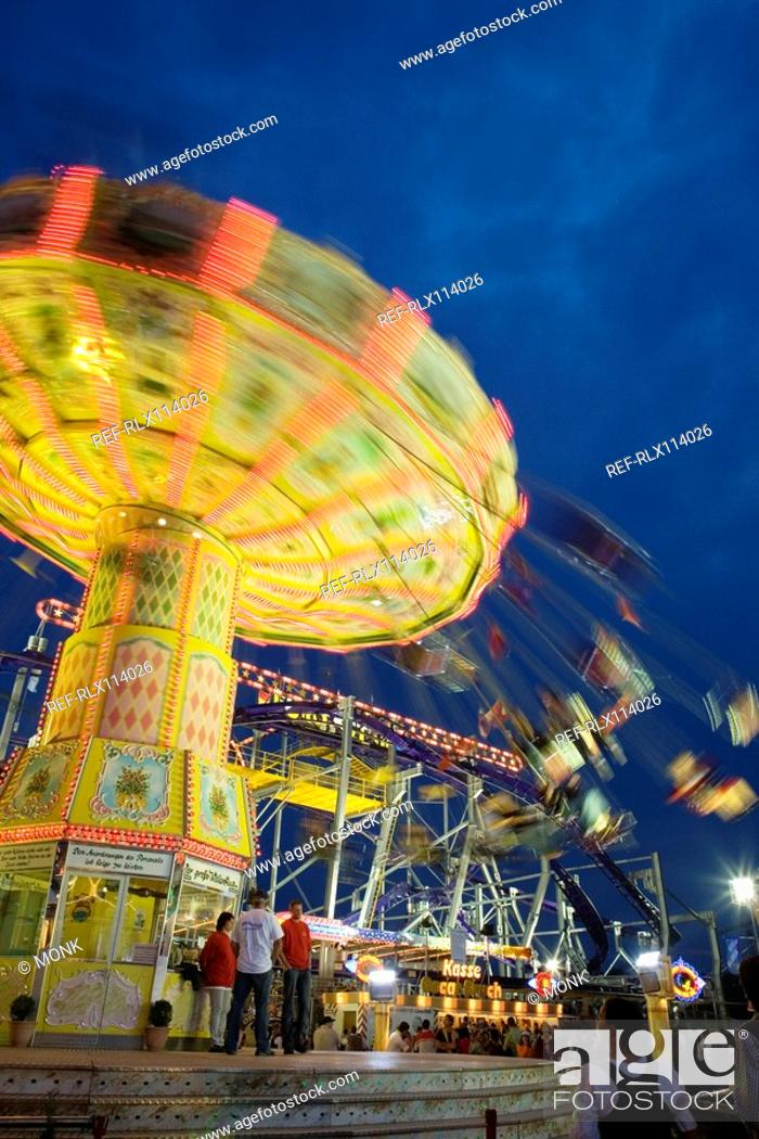 Stock Photo: Illuminated fairground rides at night, Oktoberfest, Munich, Germany.