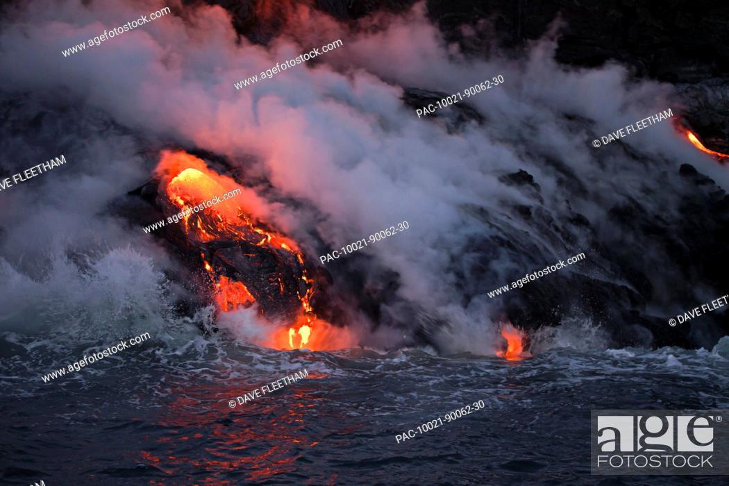 Stock Photo: Hawaii, Big Island, Kalapana, Pahoehoe lava flowing from Kilauea reaching the Pacific Ocean.