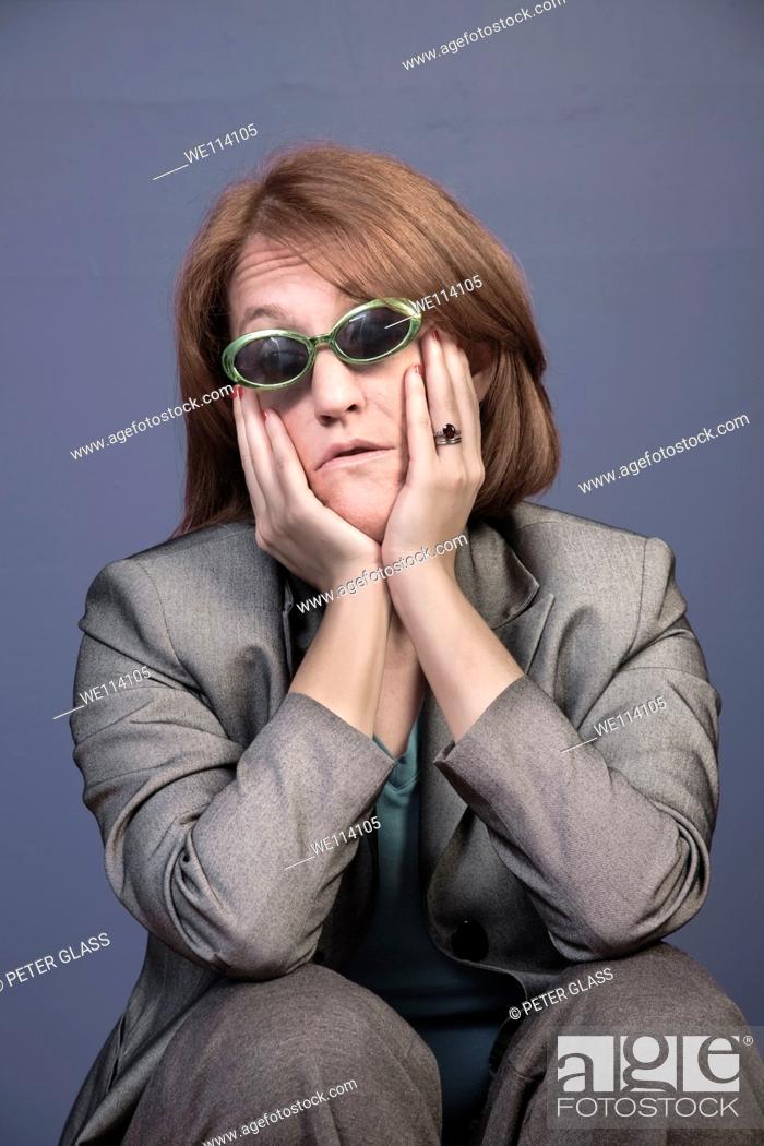 Stock Photo: Woman wearing sunglasses.