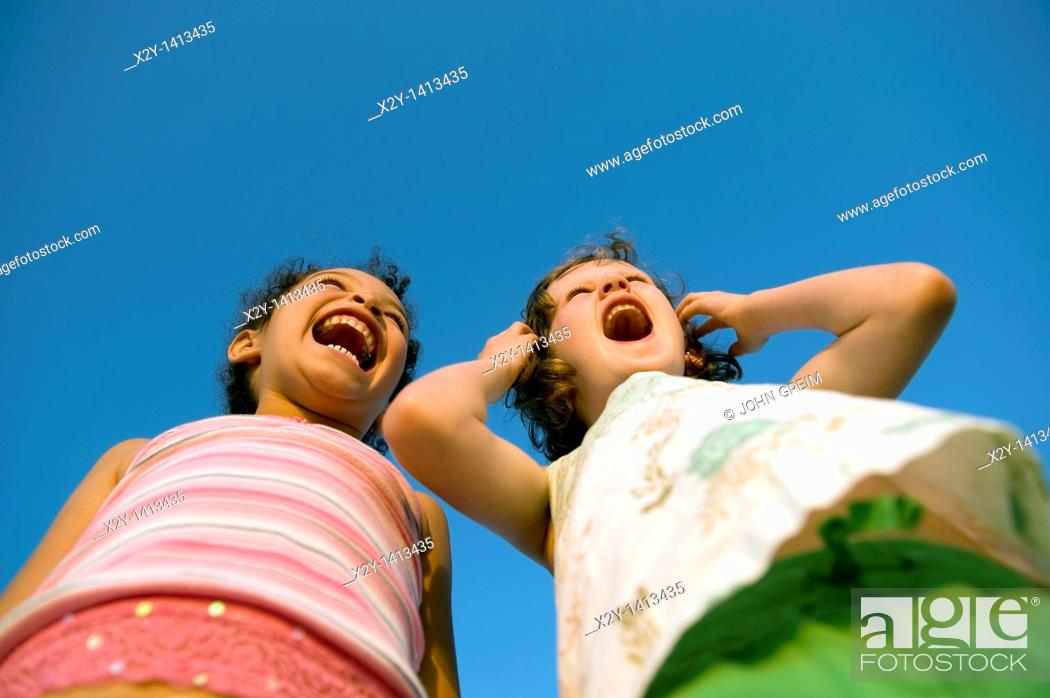 Stock Photo: Girlfriends yelling in delight.