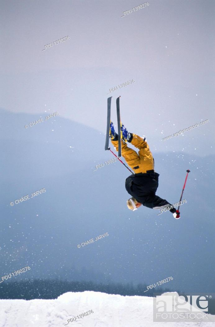 Stock Photo: Skier doing backflip, mid-air.