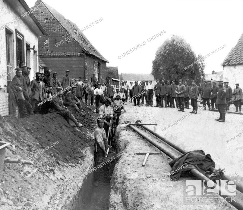 Stock Photo: France: c. 1916 German engineers working to bring a fresh water pipe right up to the front line trenches in France.