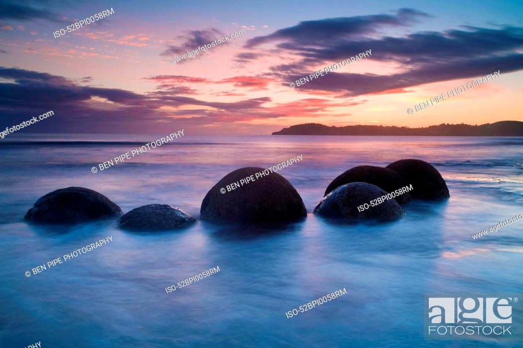 Stock Photo: Waves washing over rocks on beach.