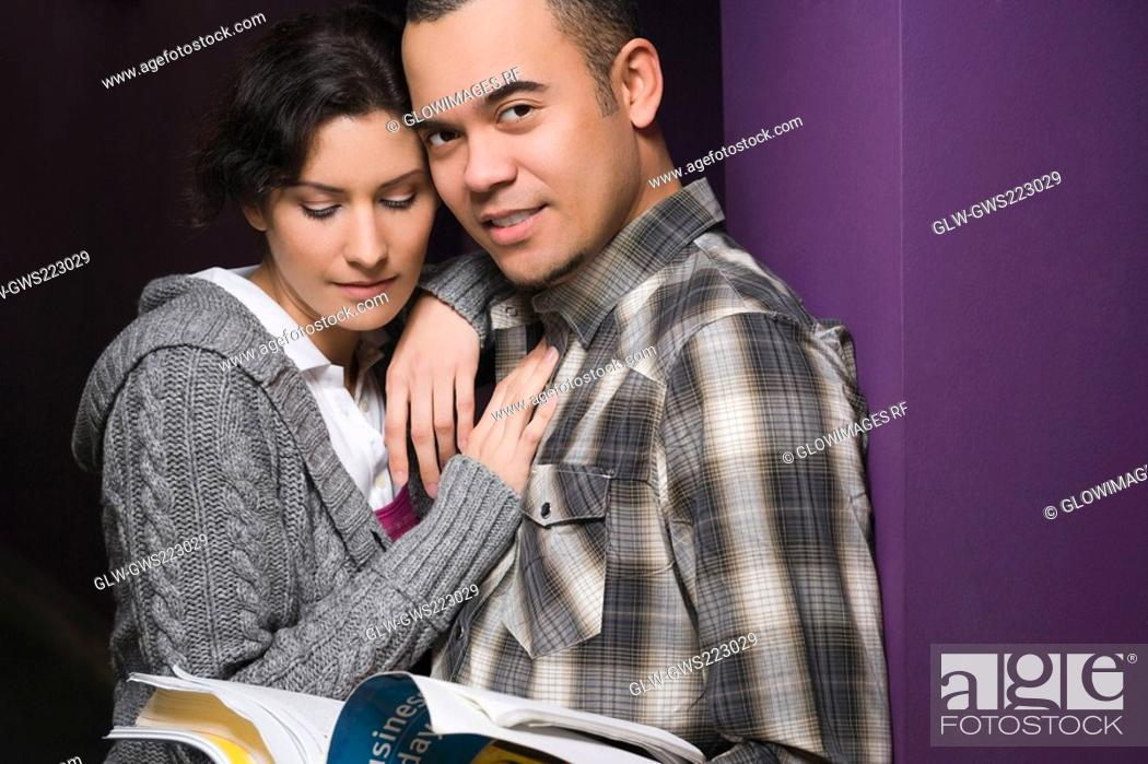 Stock Photo: Close-up of a young couple leaning against a wall.