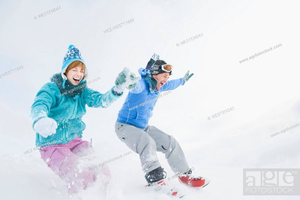Stock Photo: Italy, South Tyrol, Seiseralm, Couple holding hands, jumping.