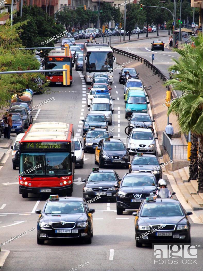 Stock Photo: Traffic jam. Cars, bus and motorcycles in Travessera de Dalt. Gràcia quarter, Barcelona, Catalonia, Spain.