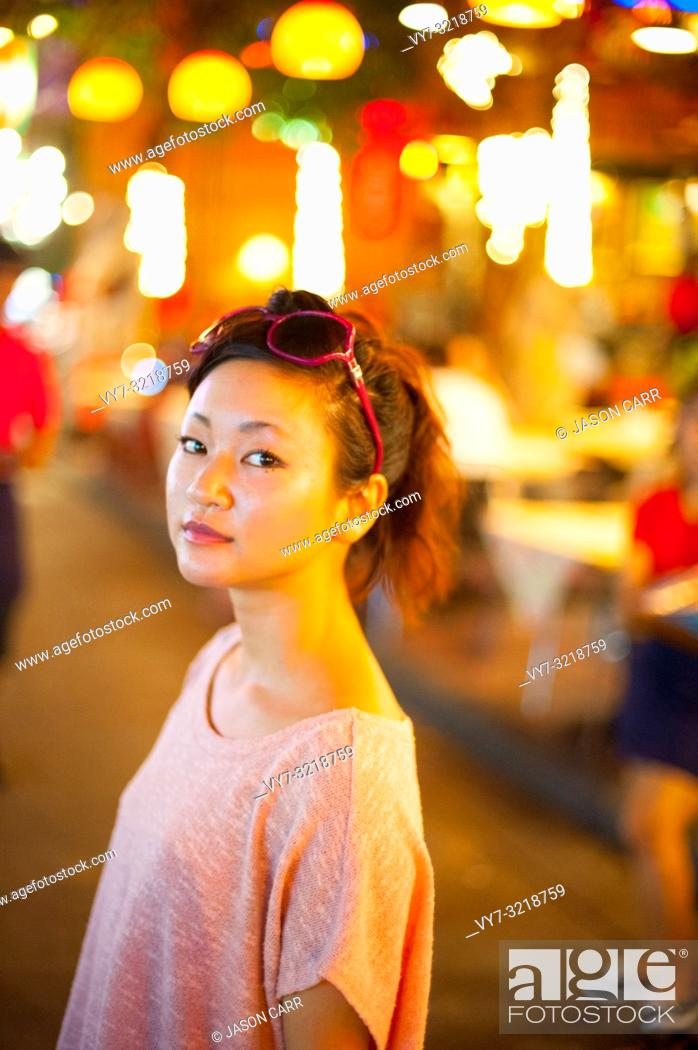 Stock Photo: Japanese girl poses for pictures in Bangkok, Thailand.