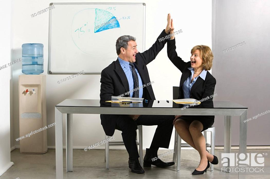 Stock Photo: Businesspeople doing high five.
