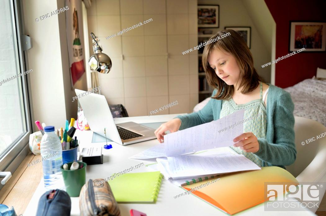 Stock Photo: Girl studying at home.