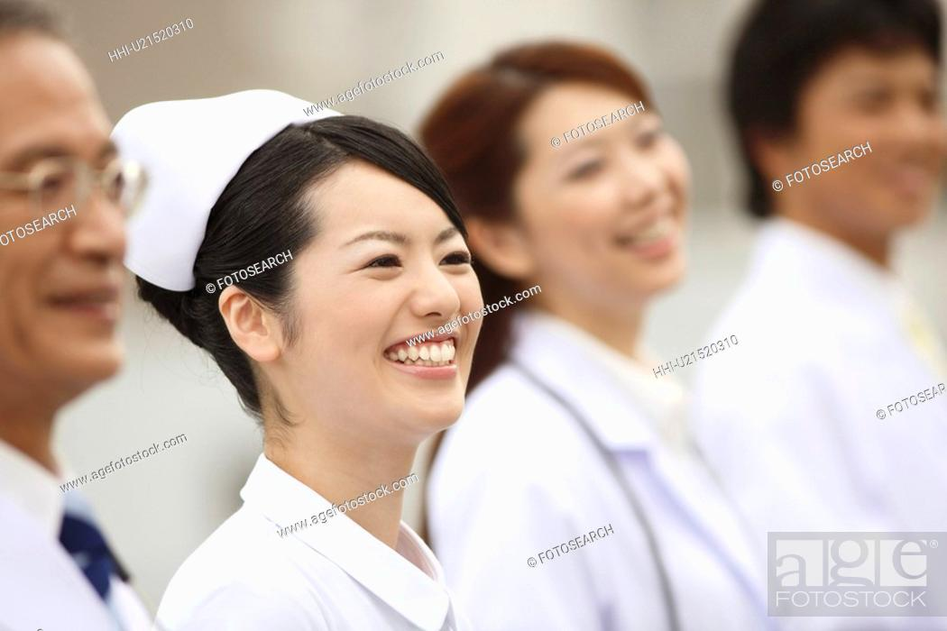Stock Photo: Smiling doctor and nurse.