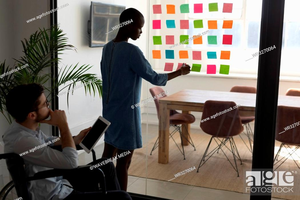Stock Photo: Executives working on sticky notes.