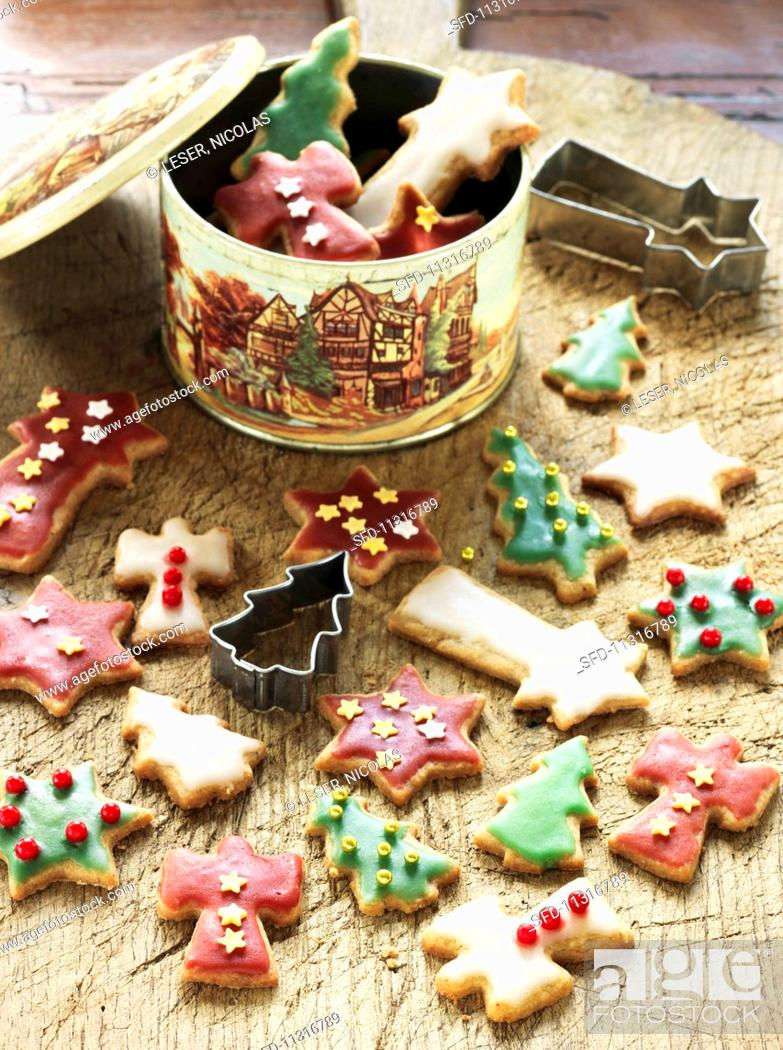 Stock Photo: Colourful butter biscuits with icing sugar (Christmas).