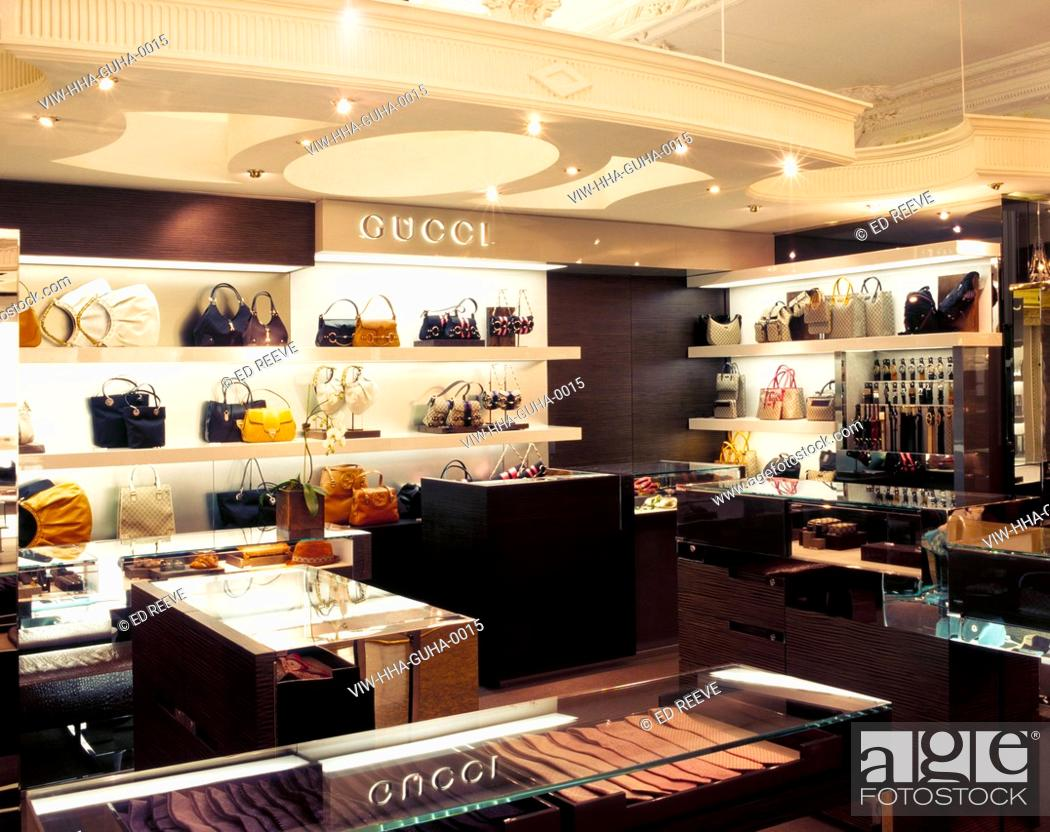 Photo de stock - GUCCI HARRODS, HOUSEHAM HENDERSON ARCHITECTS, LONDON, VIEW  OF ACCESSORIES ON DISPLAY ON SHELVES AND GLASS TABLES f3e6c86f6ad