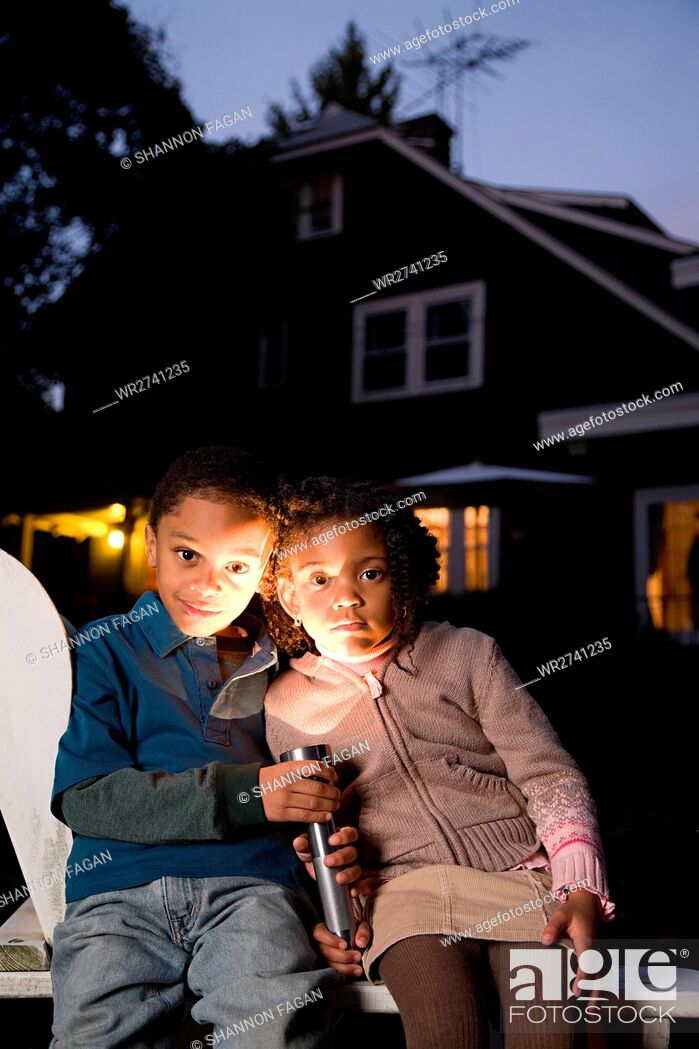 Stock Photo: Brother and sister with torch on Halloween.