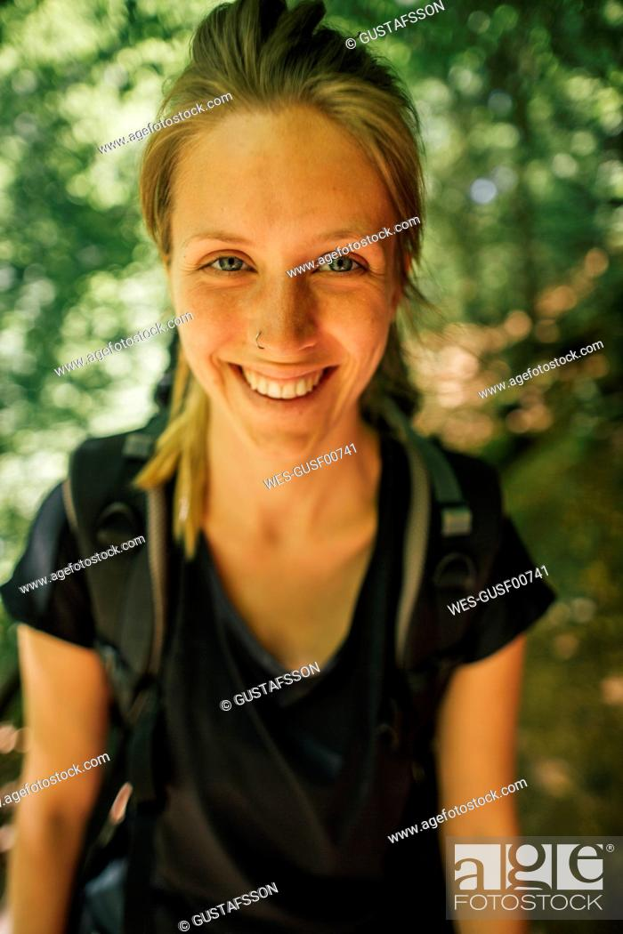 Photo de stock: Portrait of smiling young woman on a hiking trip.
