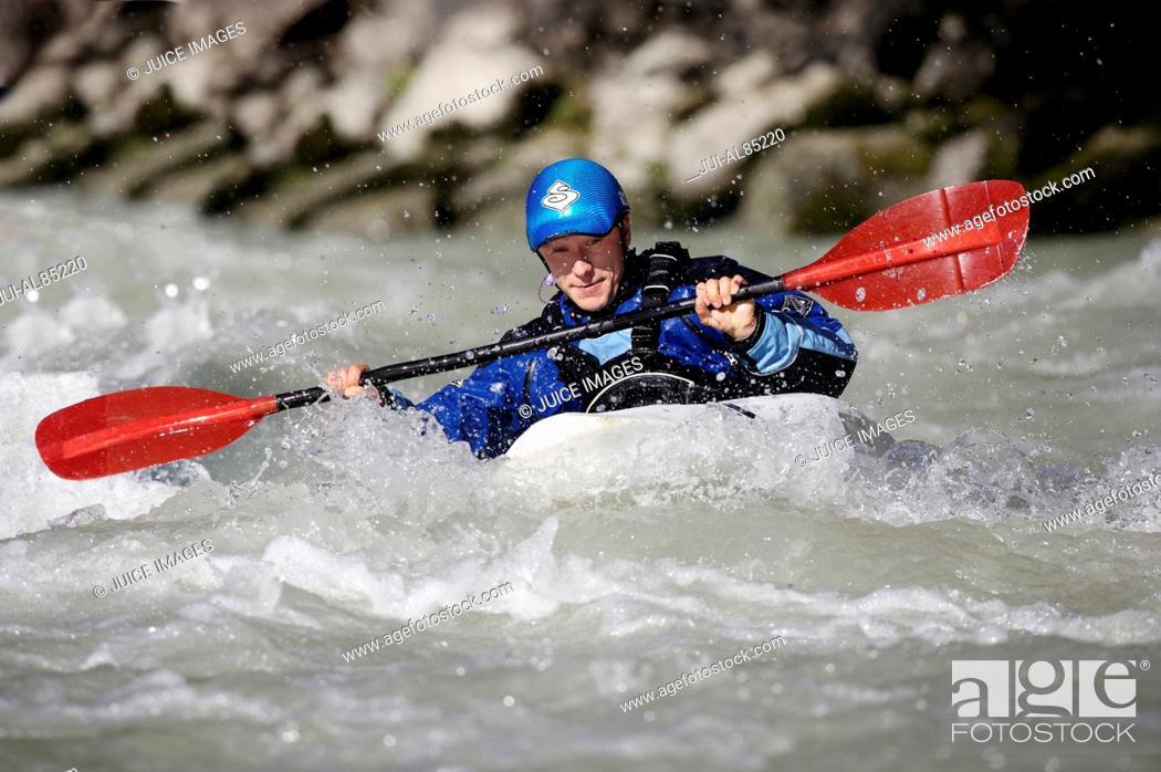 Stock Photo: Person paddling kayak in whitewater.