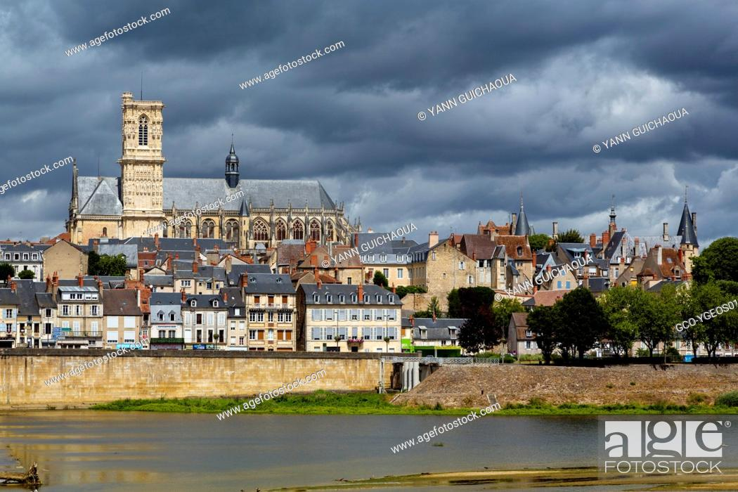 Stock Photo: Cathedral Saint Cyr and Sainte Julitte and bridge across the river Loire, Nevers, Nievre, France.