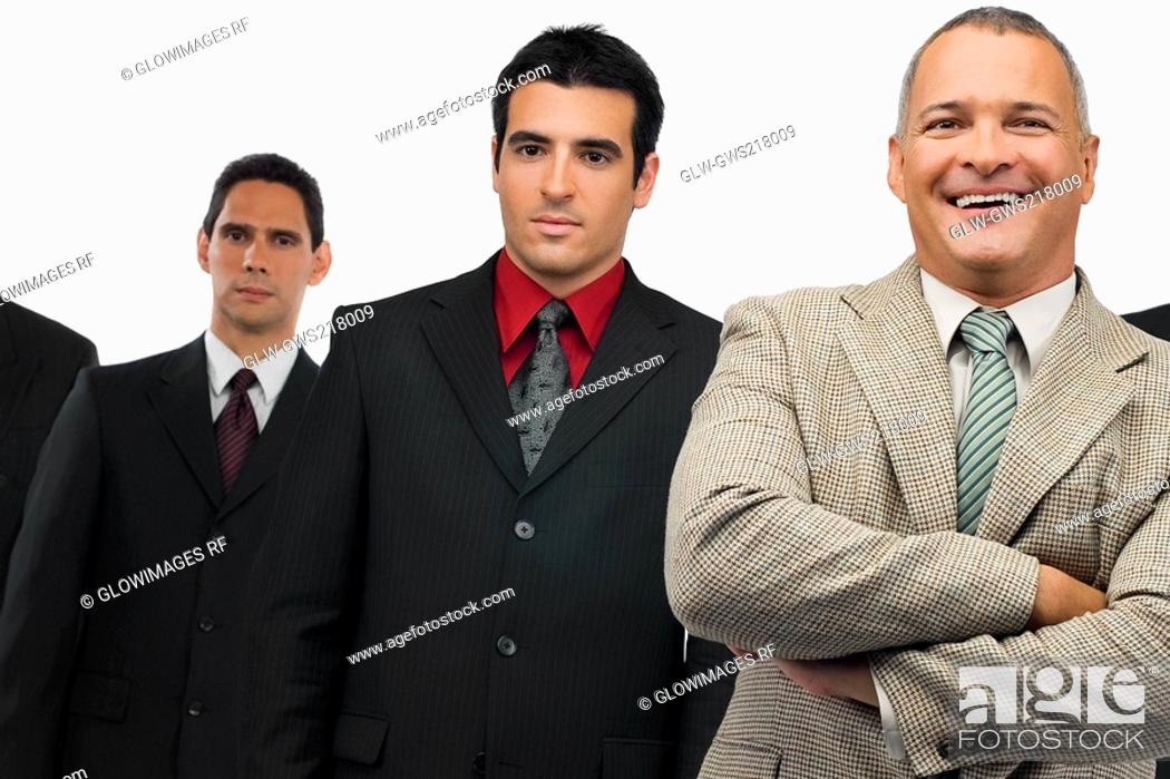 Stock Photo: Portrait of a businessman smiling and three businessmen standing behind him.