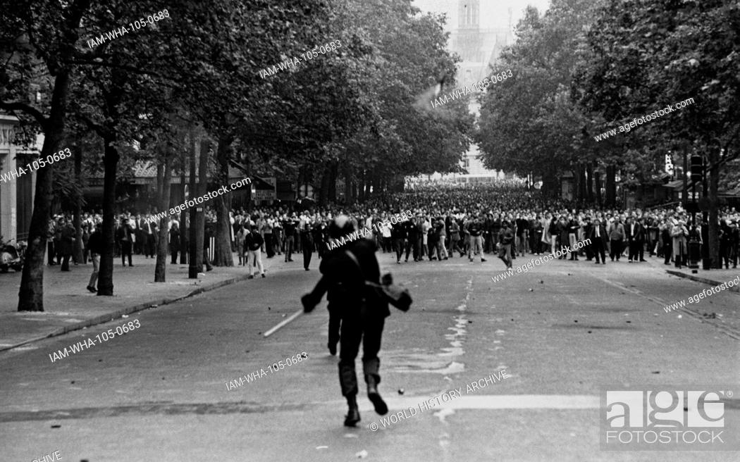 Stock Photo: Police fire tear gas to control riots in Paris during the 1968 student demonstrations in France.