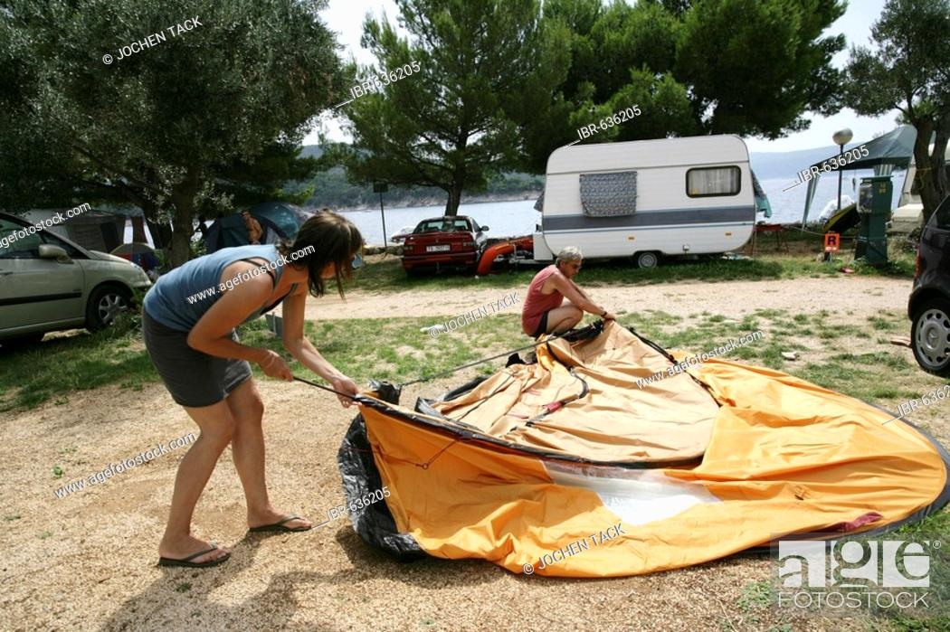 Stock Photo - Setting up a tent at Kovacine C&ground with its concrete beach swimming and boat docks Cres Island Croatia Europe & Setting up a tent at Kovacine Campground with its concrete beach ...